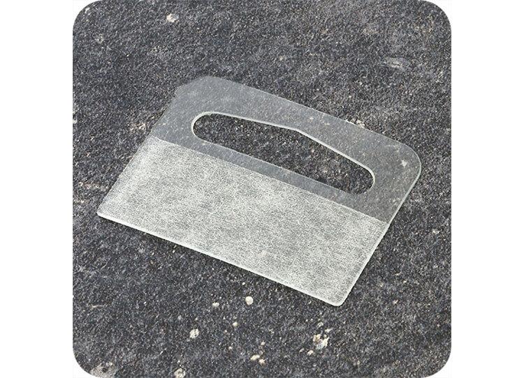 legatoria Appendini trasparenti autoadesivi per blister 42x33mm foratura a delta, in PET trasparente flessibile da 320 micron, per oggetti fino a 275 grammi. In rotolo.